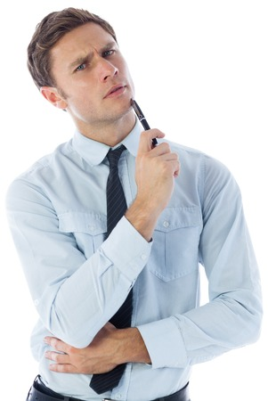 Thinking businessman holding pen on white background photo