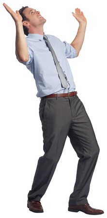 Businessman posing with arms raised on white background Stock Photo