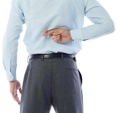 crossing fingers: Businessman crossing fingers behind his back on white background Stock Photo