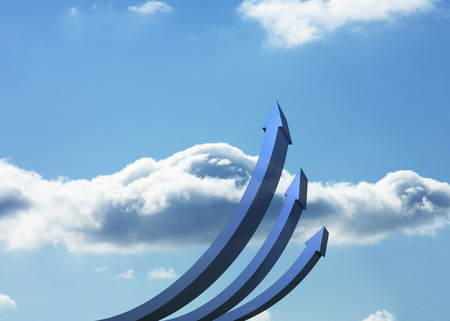 curved arrows: Blue curved arrows pointing up against sky Stock Photo