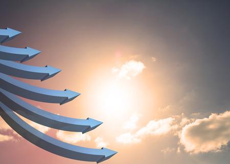flechas curvas: Flechas curvas azules apuntando contra el cielo Foto de archivo