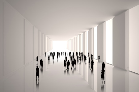 incidental people: Tiny figures in white hall Stock Photo