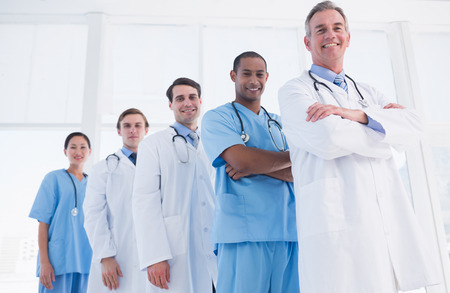 Group portrait of doctors standing in a row at the hospital photo