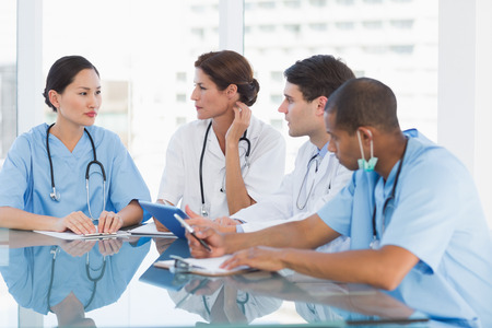 Group of young doctors in a meeting at hospital Stock Photo