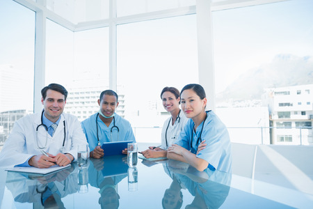 professional: Group portrait of young doctors in a meeting at hospital
