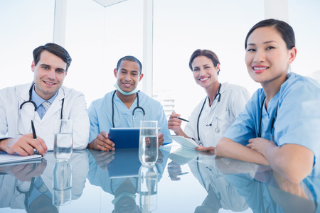 Group portrait of young doctors in a meeting at hospital photo