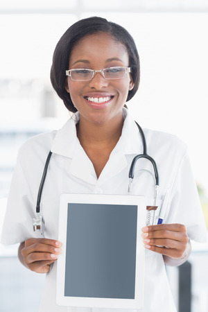 Smiling female doctor holding a digital tablet in the hospital photo