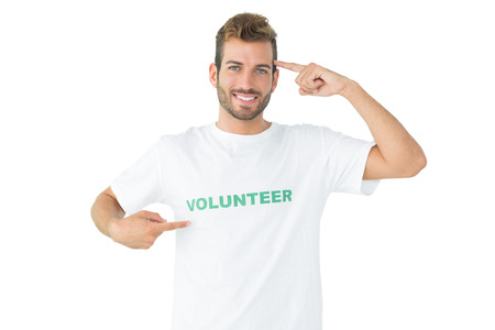 Portrait of a happy male volunteer pointing to himself over white background photo