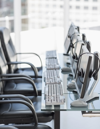Side view of chairs, computers and headset in a modern office or training center