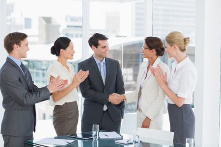 Handshake to seal a deal after a job recruitment meeting in an office Stock Photo