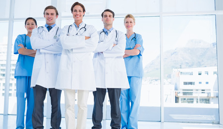 Group portrait of young doctors standing together at the hospital photo