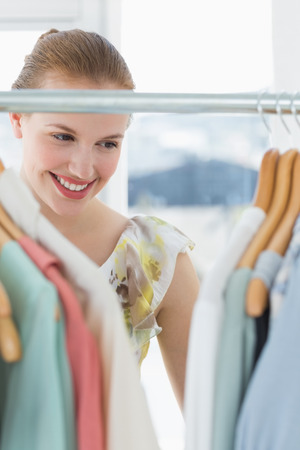 Close-up of a beautiful female customer selecting clothes at store photo