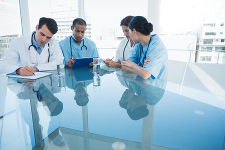 Group of young doctors in a meeting at hospital photo