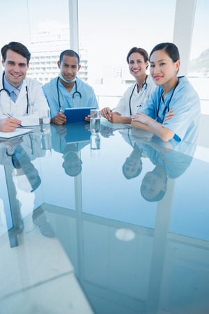 Group portrait of young doctors in a meeting at hospital