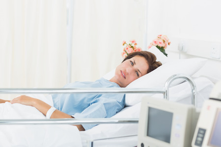 Female patient lying in medical bed at the hospital ward Stock Photo