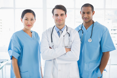 Group portrait of three doctors standing together at the hospital photo