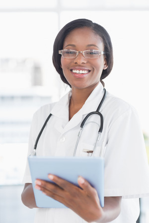 Smiling female doctor using digital tablet in the hospital photo