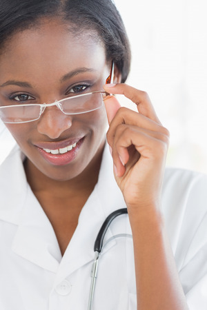 Close-up portrait of a female doctor with eye glasses in the hospital photo