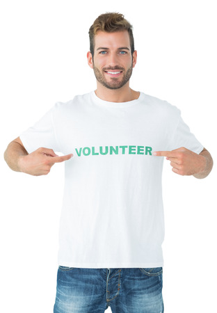 volunteer point: Portrait of a happy male volunteer pointing to himself over white background