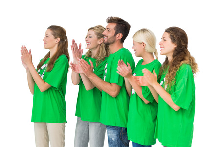 Side view of young people in recycling symbol t-shirts clapping hands over white background