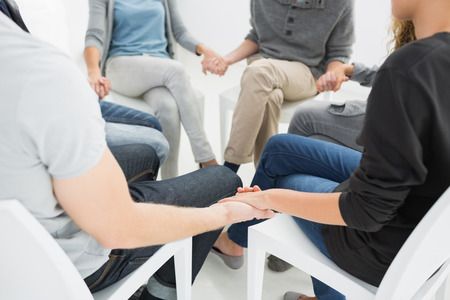therapy group: Group therapy in session sitting in a circle with therapist