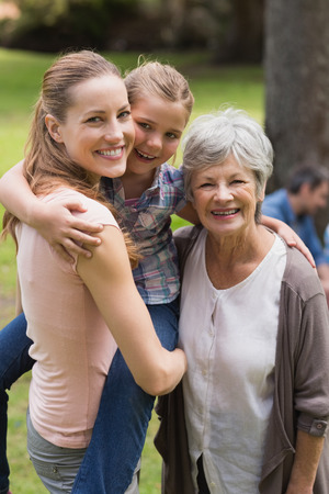 Portrait of grandmother, mother and daughter standing at the park photo