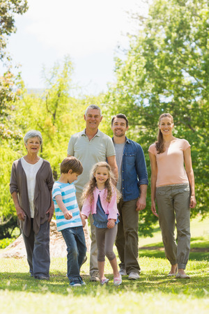 Full length of an extended family walking in the park photo