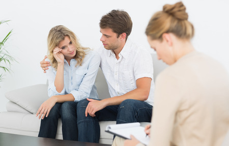 sad couple: Young couple in meeting with a financial adviser at home