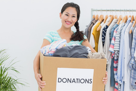 Portrait of a young woman with clothes donation photo