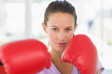 Closeup portrait of a determined female boxer in the gym photo