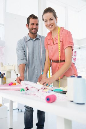 Male and female fashion designers at work in a bright studio photo