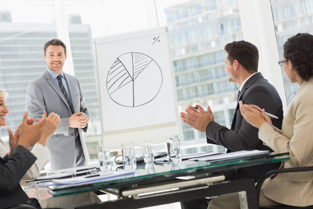 Businessman presenting new project to partners Stock Photo