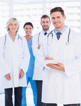 medical staff: Portrait of confident happy group of doctors standing at the medical office