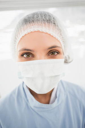 surgical cap: Close-up portrait of a female surgeon wearing surgical cap and mask in the hospital