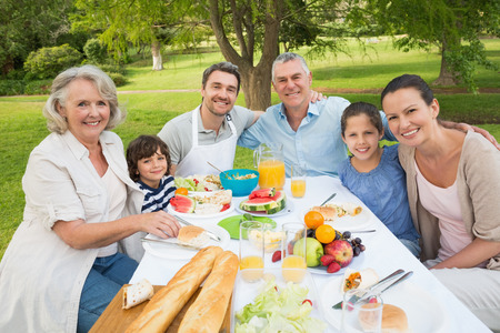 family dining: Portrait of extended family dining at outdoor table