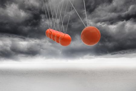 newton's cradle: Newtons cradle above stormy desert Stock Photo