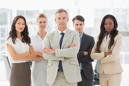 Business team looking at camera with arms crossed in the office photo
