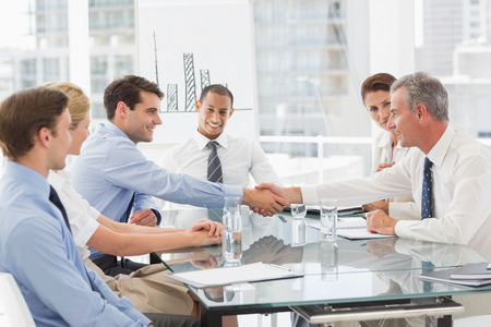 business  deal: Business people making a deal at a meeting in the office Stock Photo