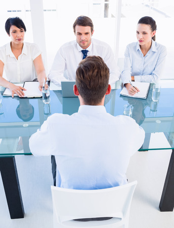 candidate: Recruiters checking the candidate during a job interview at office