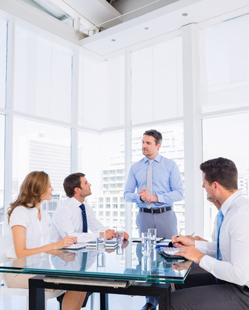 smartly: Smartly dressed young executives sitting around conference table in office Stock Photo