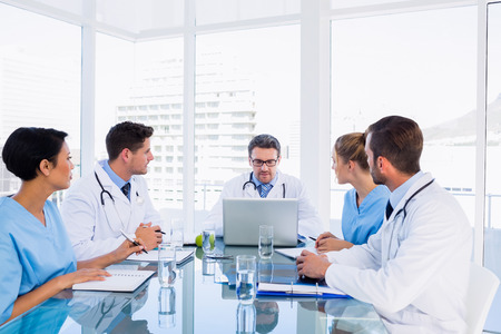 Concentrated medical team around desk in the office photo
