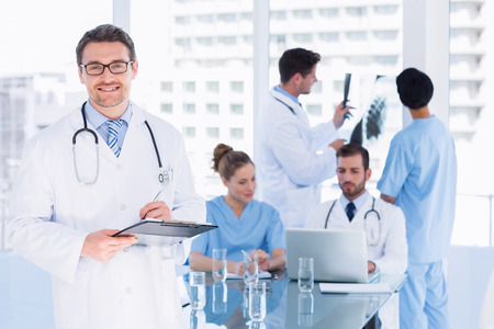 Concentrated Doctors At Work In The Medical Office Stock Photo ...