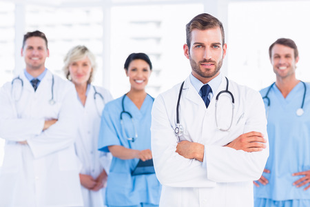 Portrait of confident happy group of doctors standing at the medical office photo
