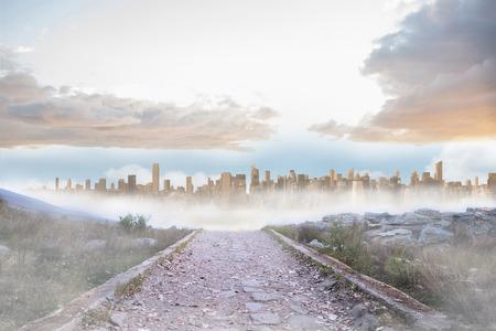 urban sprawl: Rocky path leading to large urban sprawl