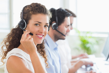 support team: Portrait of confident female call center agent working in office Stock Photo