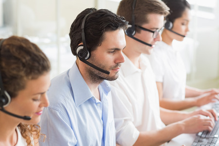 call center office: Customer service agents working in office Stock Photo