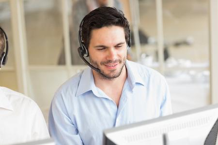 call center representative: Male customer service operator wearing headset at work