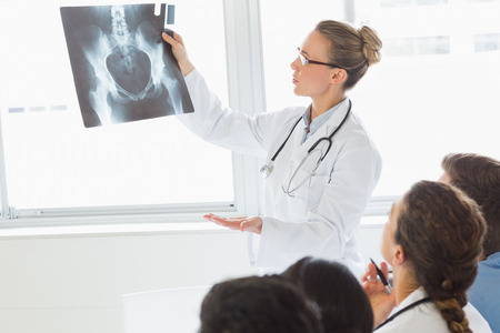 Doctor and colleagues examining Xray in hospital photo