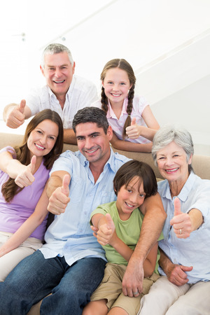 multigeneration: Portrait of happy multigeneration family gesturing thumbs up at home