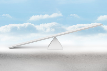 see saw: White scales in front of clouds Stock Photo